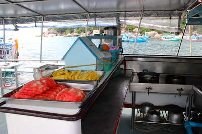 dive boat with fruit, water, coffee and tea