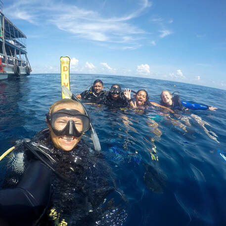 Scuba Instructor Sanne and her PADI open Water students on the surface at Shark Island